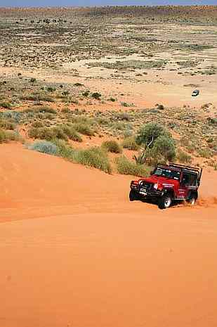 Australian 4x4 Tag Along Tours Jeep on Big Red sand dune